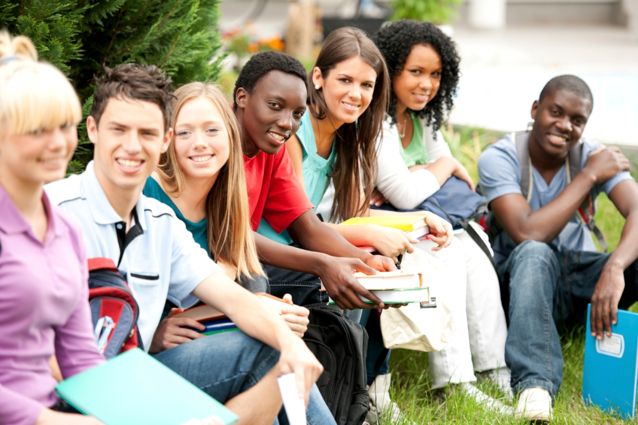 Group of teenage students enjoying outside.