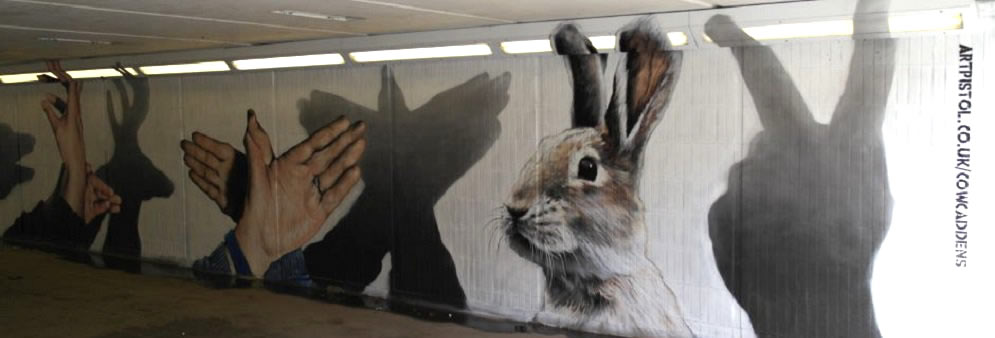 Graffiti manos forma animal, en Glasgow