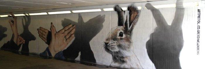 Graffiti manos forma animal, en Glasgow
