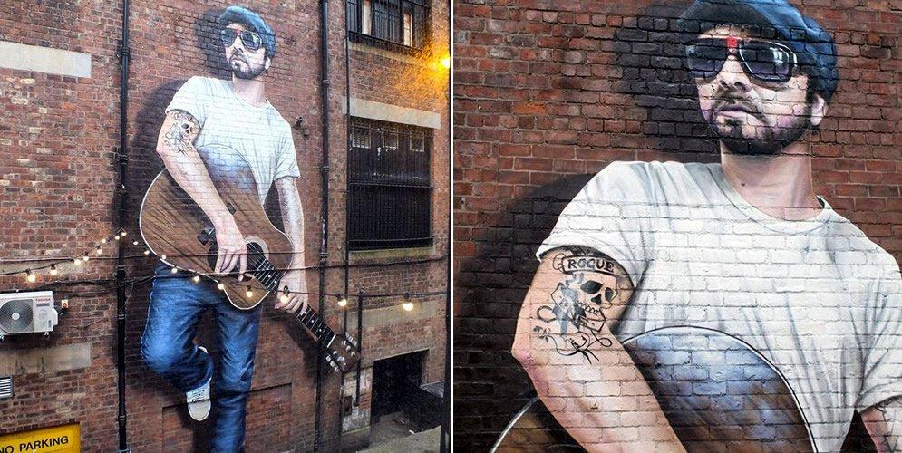 Graffiti de un músico en Glasgow